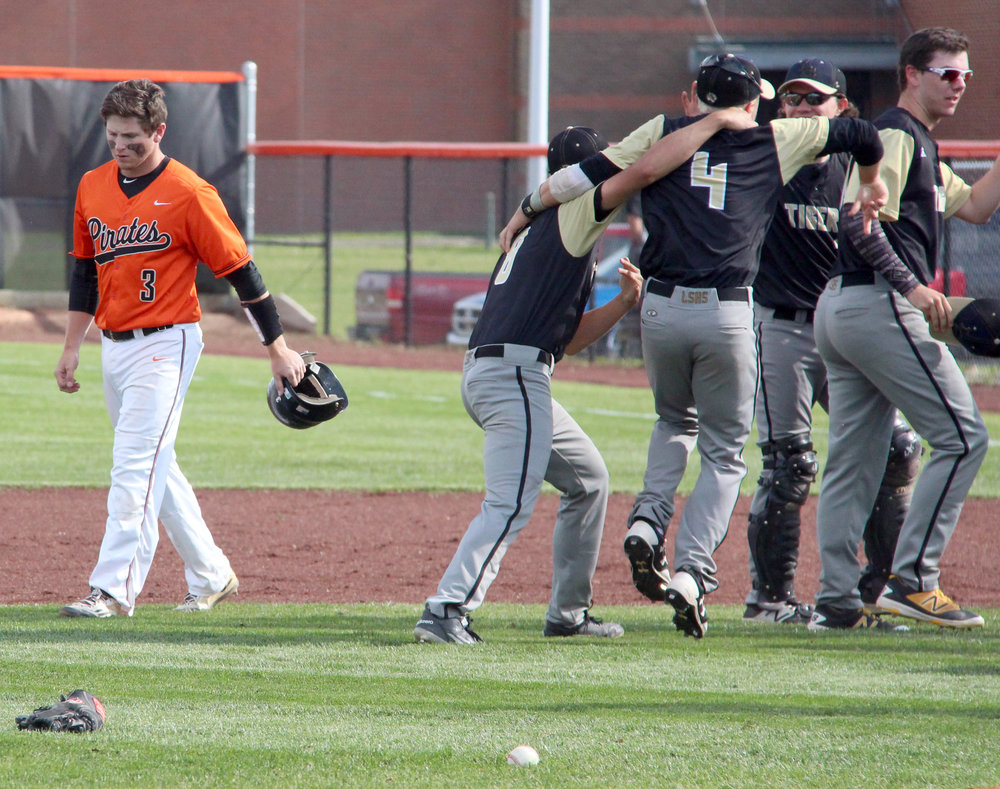 ROSS MARTIN/Citizen photo Platte County senior Dillon Doll, left, walks off the field Thursday, May 25 at Platte County High School after the final out of a 1-0 loss to Lee's Summit in a Class 5 quarterfinal matchup.
