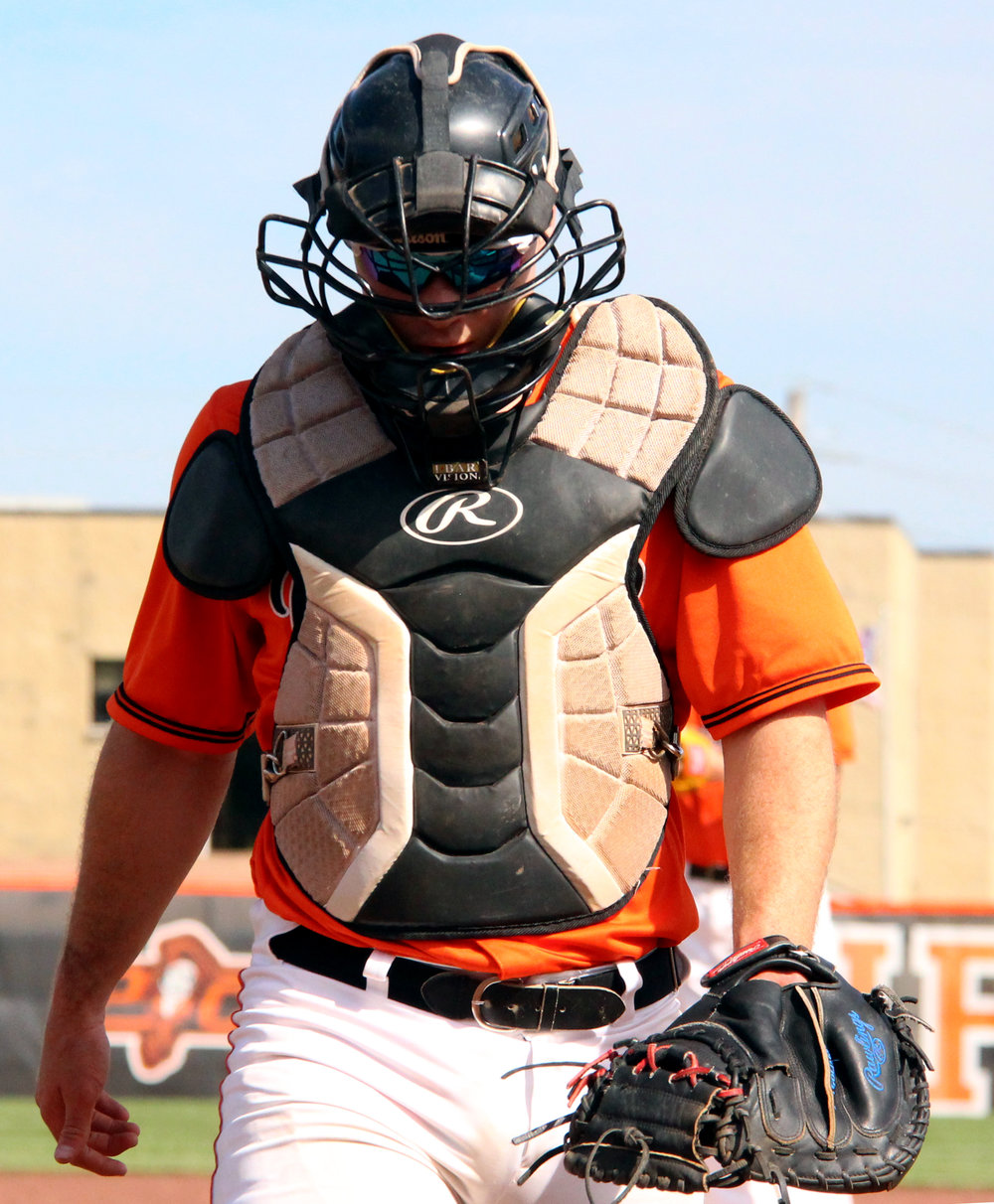 ROSS MARTIN/Citizen photo ABOVE: Platte County senior Jared Wilson walks out of the dugout as Lee's Summit players celebrate a 1-0 win in a Class 5 quarterfinal Thursday, May 25 at Platte County High School. RIGHT: Platte County junior centerfielder Kobe Cummings comes in to make a catch. BELOW: Platte County senior catcher Justin Mitchell walks back to home plate after a conversation on the mound.