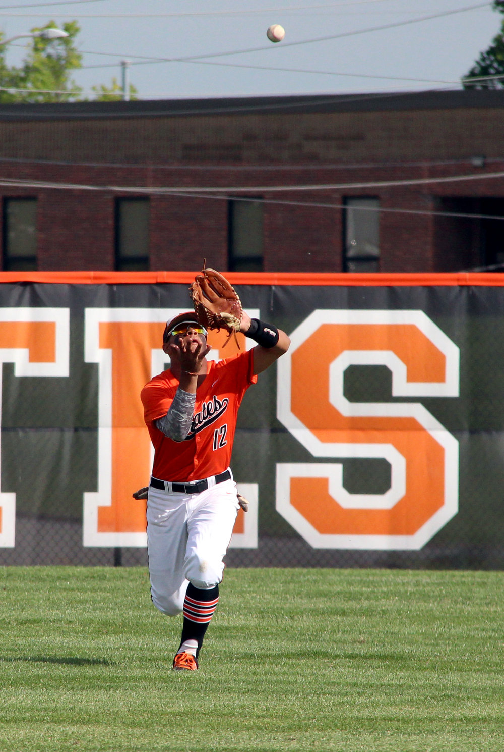 ROSS MARTIN/Citizen photo Platte County junior centerfielder Kobe Cummings comes in to make a catch.