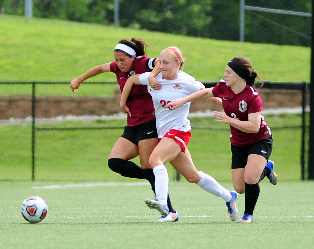 NICK INGRAM/Citizen photo Park Hill junior Alison Walls, center, tries to fight through two Lee's Summit North defenders during a Class 4 quarterfinal Saturday, May 27 at Park Hill District Soccer Complex in Riverside, Mo.