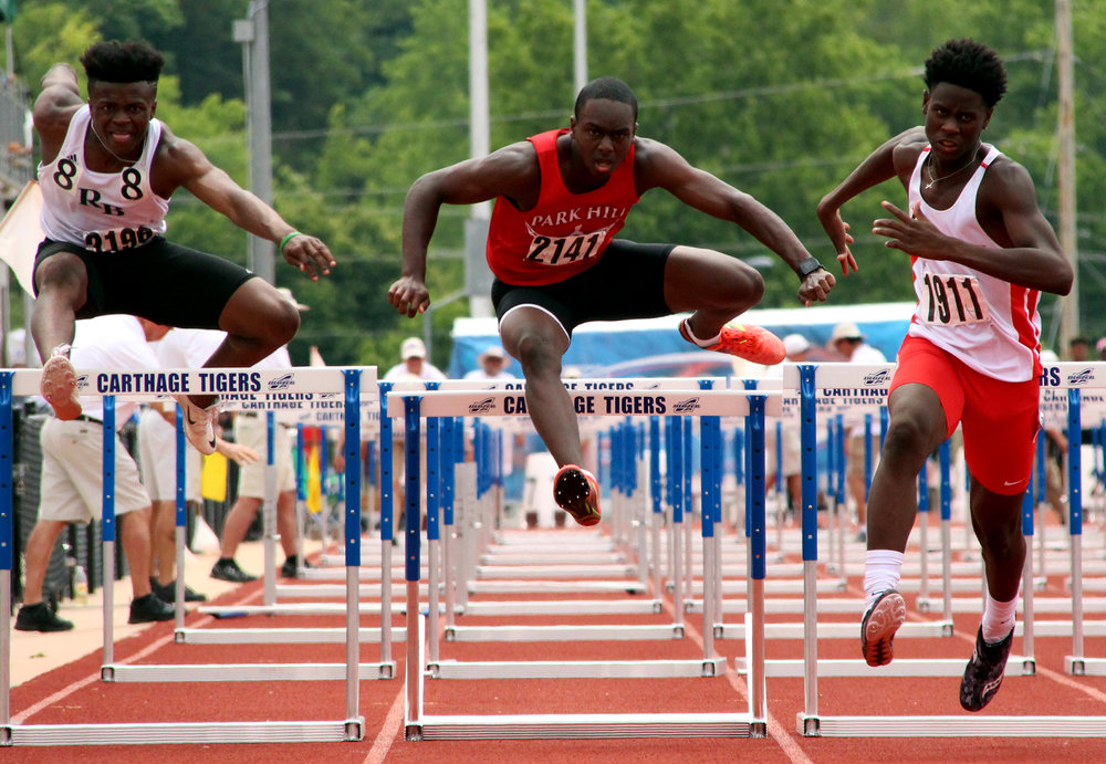 ROSS MARTIN/Citizen photo Park Hill senior Grant Downes, center, runs in the Class 5 Missouri State Track and Field Championships' 110-meter hurdles final Saturday, May 27 at Adkins Stadium in Jefferson City, Mo.