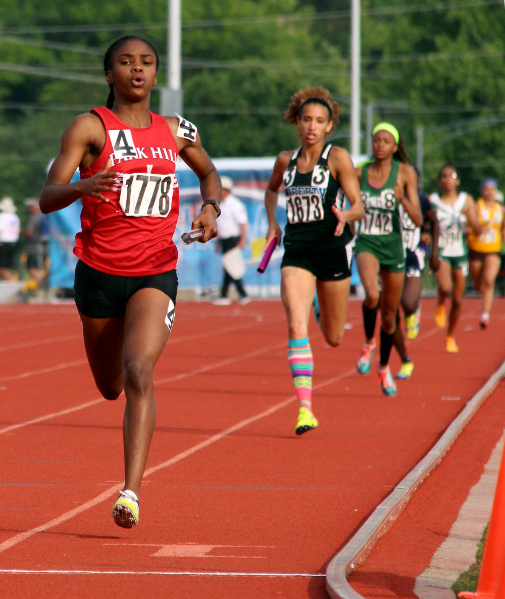 ROSS MARTIN/Citizen photo Park Hill junior Taiya Shelby, left, leads the finishers in a Class 5 Missouri State Track and Field Championships' 4x400- meter preliminary race Friday, May 26 at Adkins Stadium in Jefferson City, Mo.