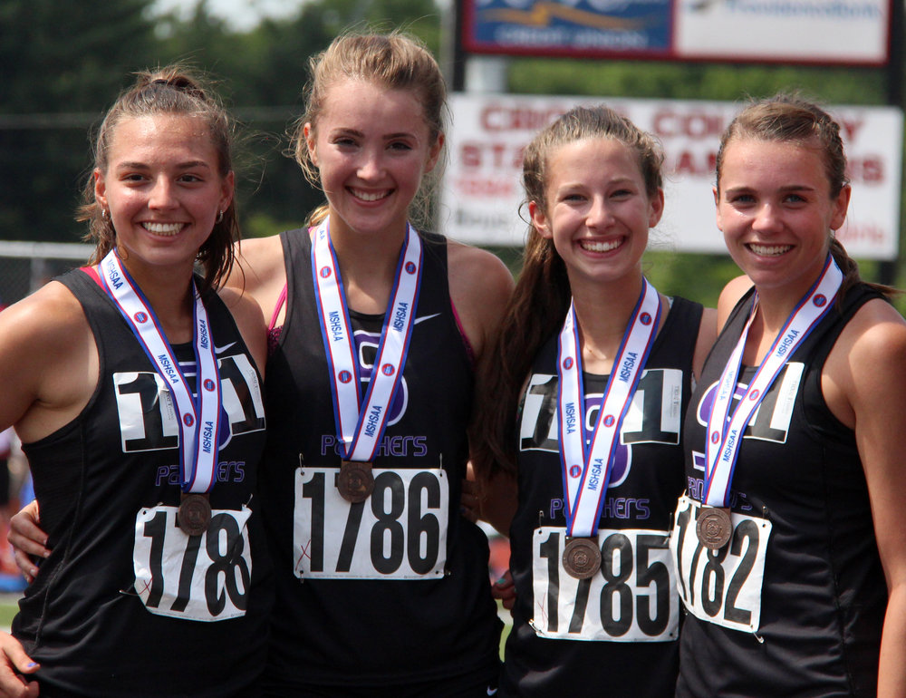 ROSS MARTIN/Citizen photo Park Hill South 4x800-meter relay team (from left) Justine Aiello, Emma Roth, Lexi Maddox and Jasmine Crawford.