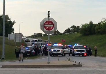Facebook.com This screengrab from a video posted Saturday, June 3 shows a suspect, left, backing up toward law enforcement officials on the 72nd Street exit off of southbound Interstate 29 after a high-speed pursuit that went through Platte County that day.
