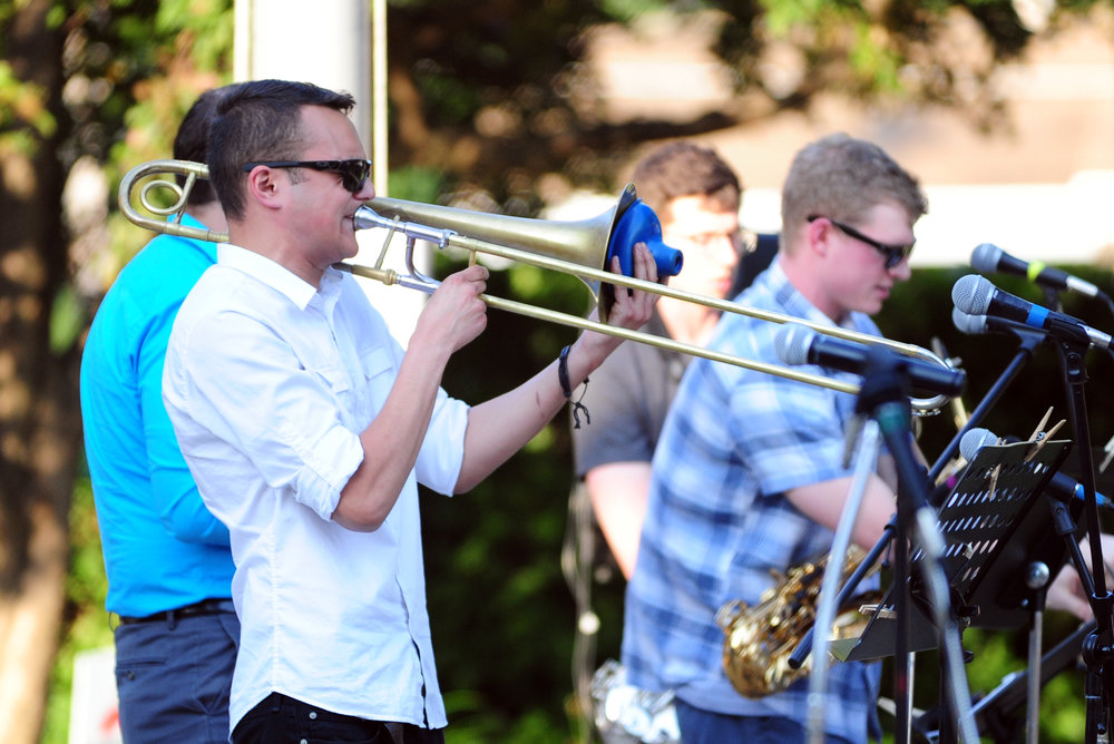 NICK INGRAM/Citizen photo Trevor Turla of Joel and Jazz Friends plays the trombone during the first show of the Platte City Friends of the Arts Summer Concert Series on Saturday, June 10 in front of the Platte County Courthouse.