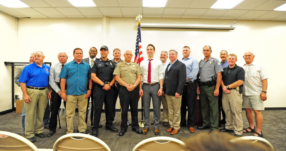 NICK INGRAM/Citizen photo Local law enforcement officials and public office holders take a picture with Missouri attorney general Josh Hawley at an event Monday, June 19 in Parkville, Mo.
