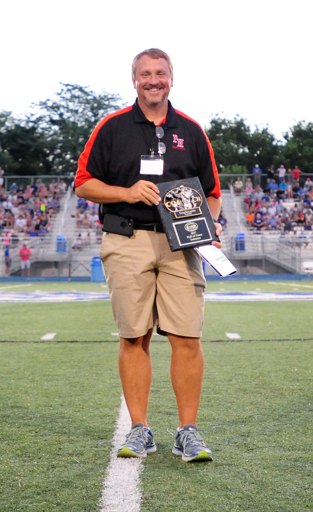 NICK INGRAM/Citizen photo The Greater Kansas City Football Coaches Association inducted former Park Hill coach Greg Reynolds into its hall of fame on Thursday, June 15 at halftime of the annual Missouri-Kansas All-Star Game held at Blue Springs South High School in Blue Springs, Mo. Reynolds led the Trojans to the 2003 Class 5 state championship.