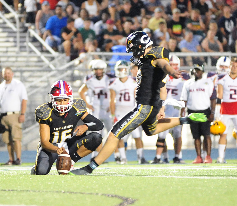 NICK INGRAM/Citizen photo Park Hill's Parker Sampson, right, hits a field goal during the Greater Kansas City Football Coaches Association All-Star Game on Thursday, June 15 in Blue Springs, Mo.