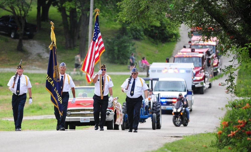 NICK INGRAM/Citizen photo Members of the American Legion Post 287 from Savannah, Mo. lead the annual parade down Third street to kick off Camden Point's Freedom Festival on Saturday, June 24 in Camden Point, Mo.