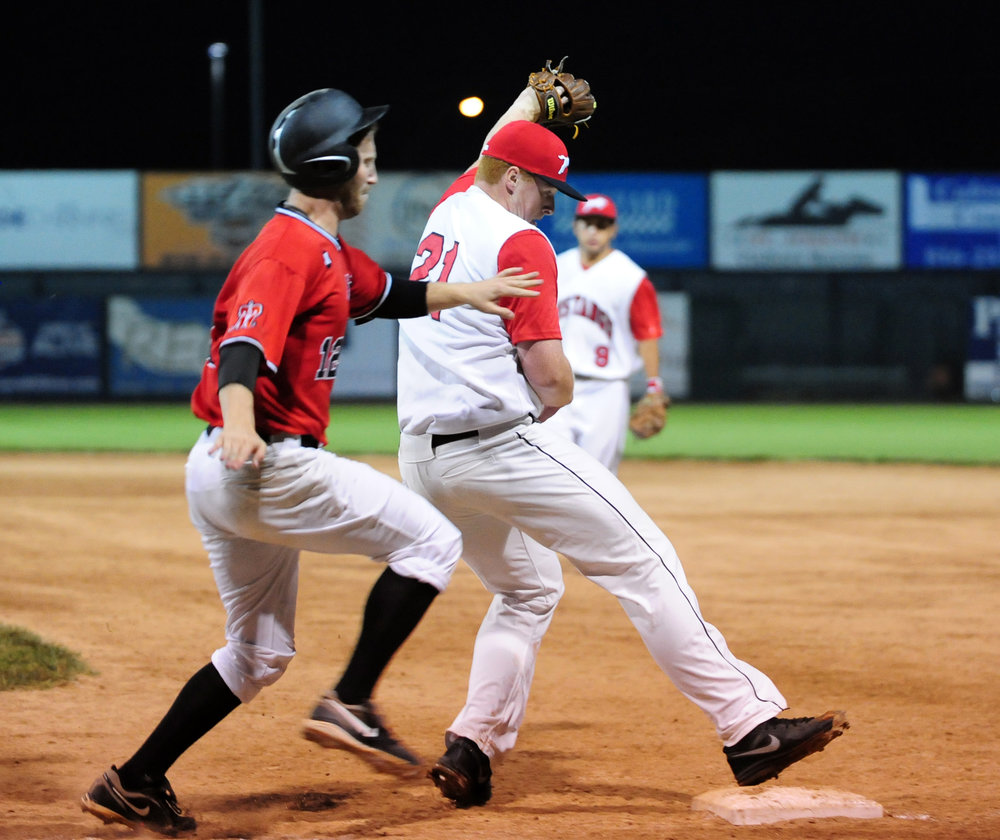 NICK INGRAM/Citizen photo Park Hill South alum Jake Purl (21) beats an opponent to first base during a St. Joseph Mustangs game against the Kansas City Monarchs  on Thursday, June 1 at Phil Welch Stadium in St. Joseph, Mo.