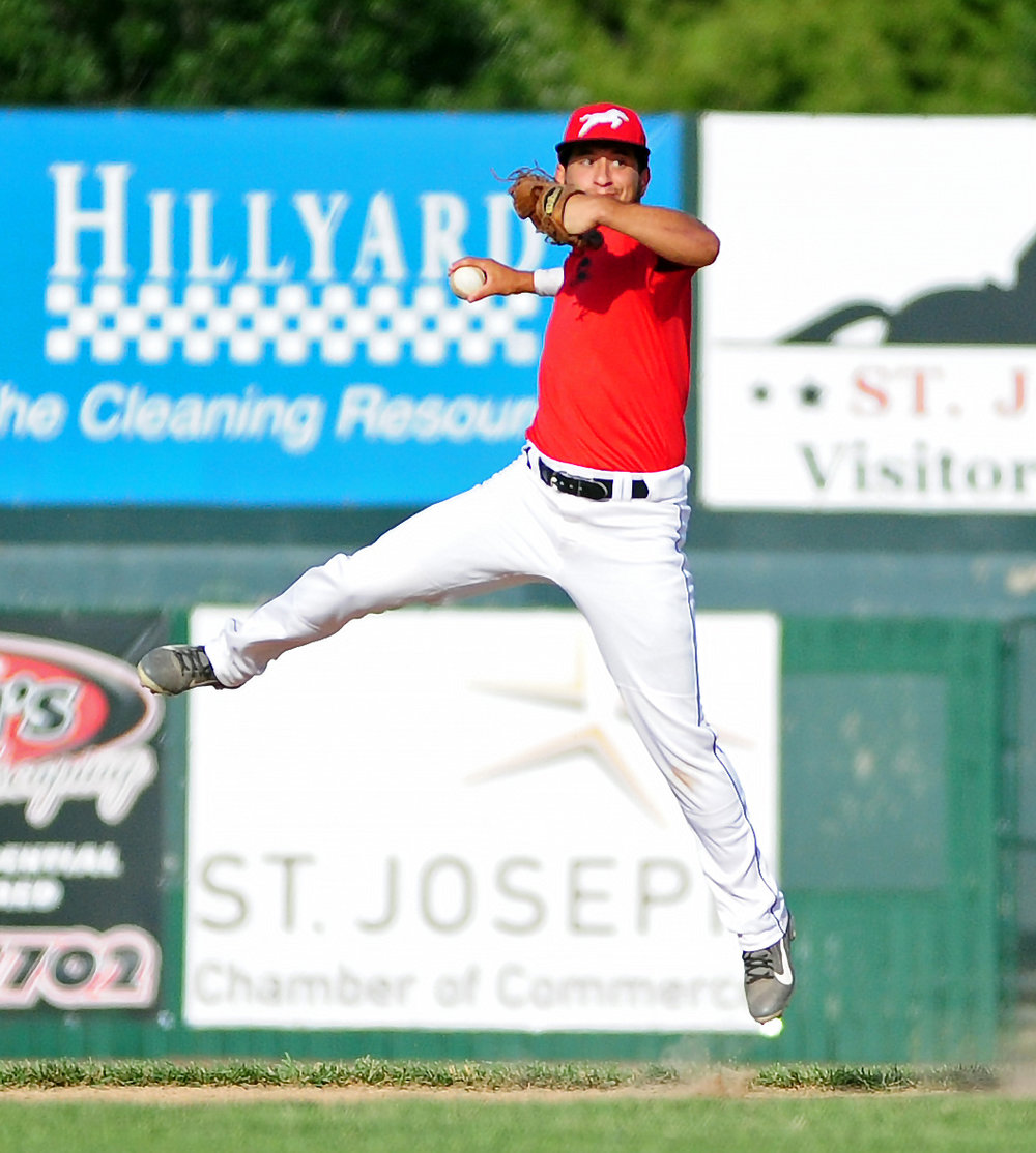 NICK INGRAM/Citizen photo Park Hill South graduate Easton Fortuna makes a leaping throw to first base during infield practice for the St. Joseph Mustangs on Wednesday, June 7 at Phil Welch Stadium in St. Joseph, Mo.