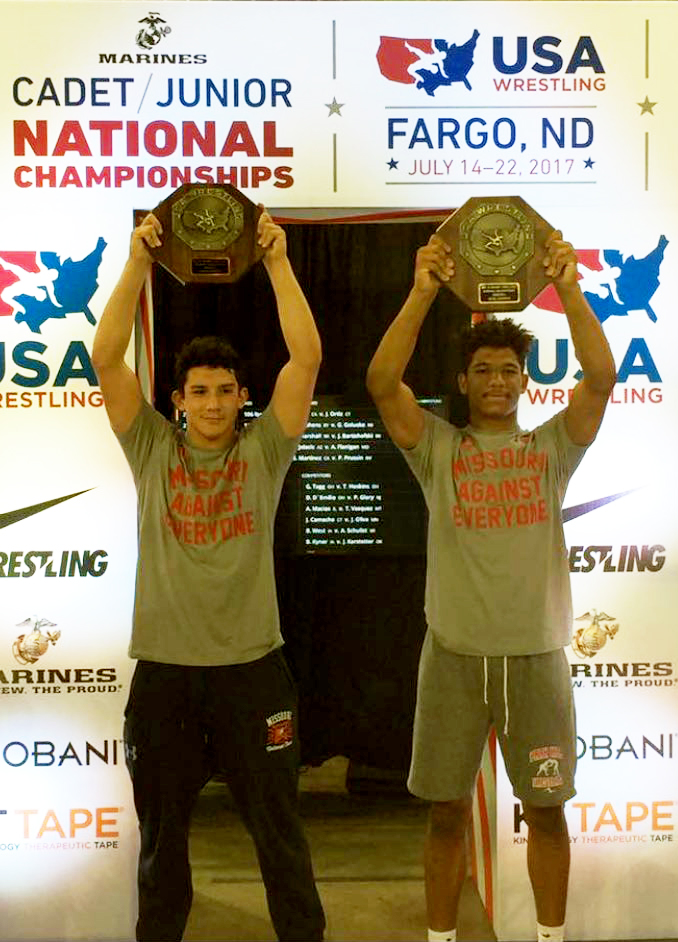 Contributed photo Park Hill's Ashton Sharp, left, and Devin Winston brought home individual titles in the USA Wrestling Cadet/Junior Freestyle and Greco Roman National Championships last month in Fargo, N.D.