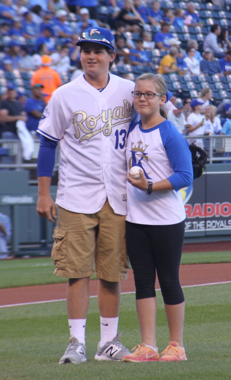 CODY THORN/Special to The Citizen Demi Riechers (right), who will be a seventh grade student this year at Platte City Middle School, received the opportunity to throw out the first pitch before the Kansas City Royals game with the Seattle Mariners on Friday, Aug. 4 at Kauffman Stadium in Kansas City, Mo. Riechers, who threw to her brother Dalton Riechers (left), was one of 10 national winners in Major League Baseball's Breaking Barriers: In Sports, In Life essay contest.
