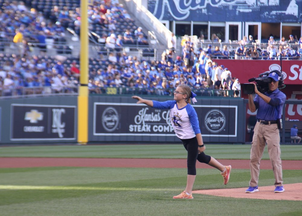 CODY THORN/Special to The Citizen Demi Riechers, who will be a seventh grade student this year at Platte City Middle School, received the opportunity to throw out the first pitch before the Kansas City Royals game with the Seattle Mariners on Friday, Aug. 4 at Kauffman Stadium in Kansas City, Mo. Riechers, throwing to her brother Dalton Riechers, was one of 10 national winners in Major League Baseball's Breaking Barriers: In Sports, In Life essay contest.