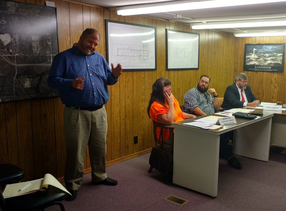 JEANETTE BROWNING FAUBION/Citizen photo Todd Schuler, Kansas City area audit manager for the Missouri State Auditor's office, spoke Tuesday, Aug. 8 during the Ferrelview Board of Trustees Meeting in Ferrelview, Mo.