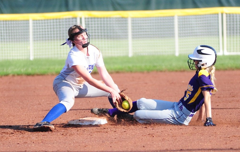 NICK INGRAM/Citizen photo North Platte senior McKenna Fulton, right, slides into second ahead of a tag from West Platte shortstop Kaitlin Larison during a North Platte Invitational game Saturday, Aug. 19 at Dean Park in Dearborn, Mo.