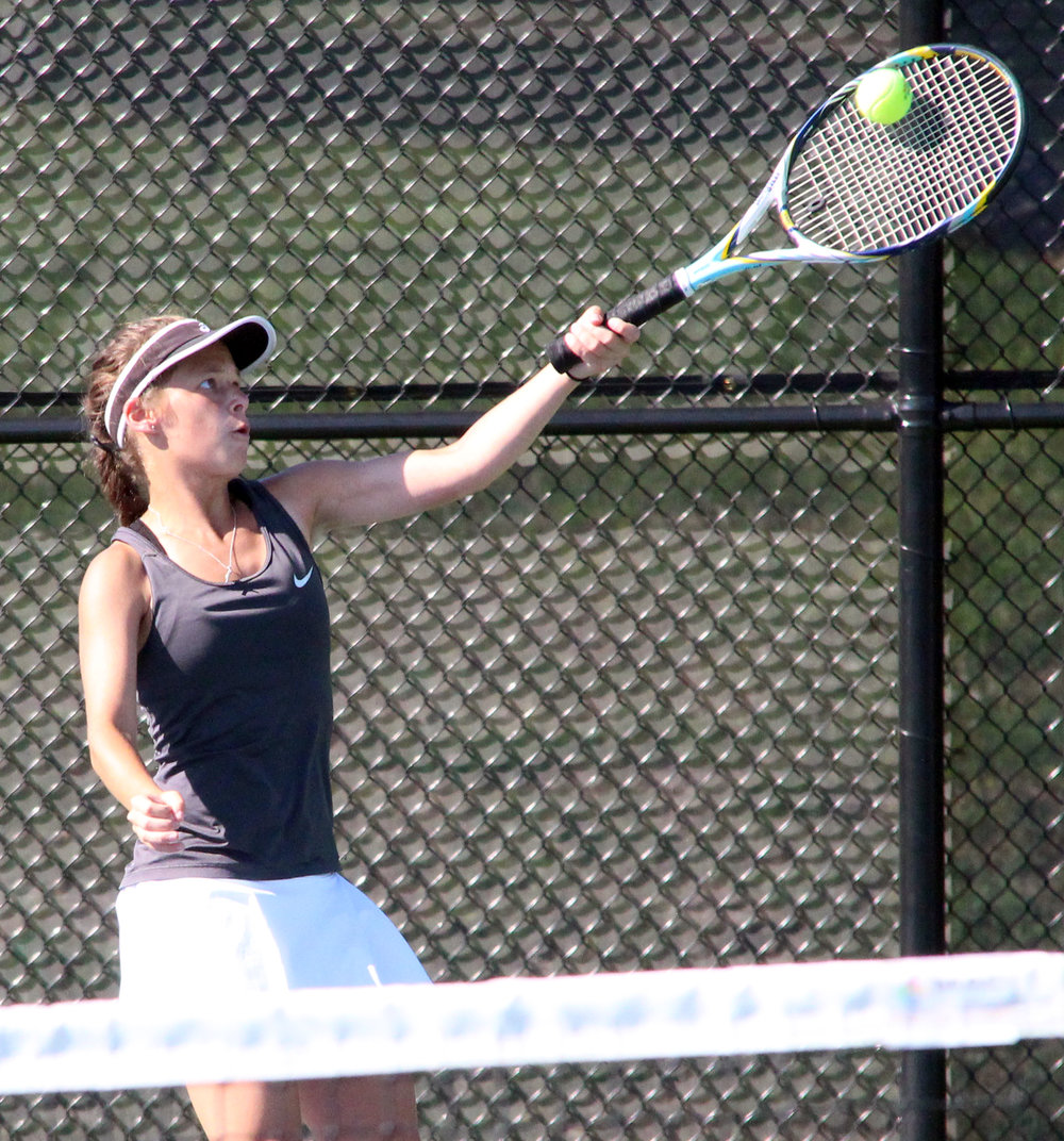 ROSS MARTIN/Citizen photo Platte County senior Brittany Alvarado reaches up to hit a forehand during the No. 3 doubles match in a dual with Grandview on Tuesday, Aug. 22 in Platte City. The Pirates won 9-0 in the first home dual in program history.