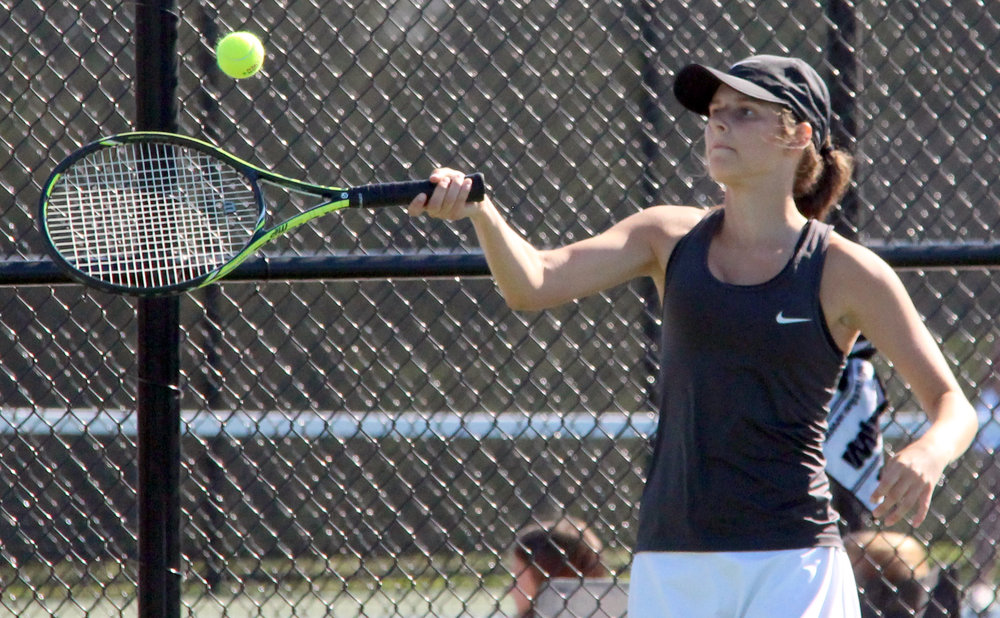 ROSS MARTIN/Citizen photo Platte County junior Hannah Valentine hits a forehand during the No. 1 singles match in a dual with Grandview on Tuesday, Aug. 22 in Platte City.
