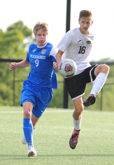 NICK INGRAM/Citizen photo RIGHT: Park Hill South senior defender Kyle Werth battles for a loose ball with a Rockhurst player during the Hawklets' 3-0 victory.