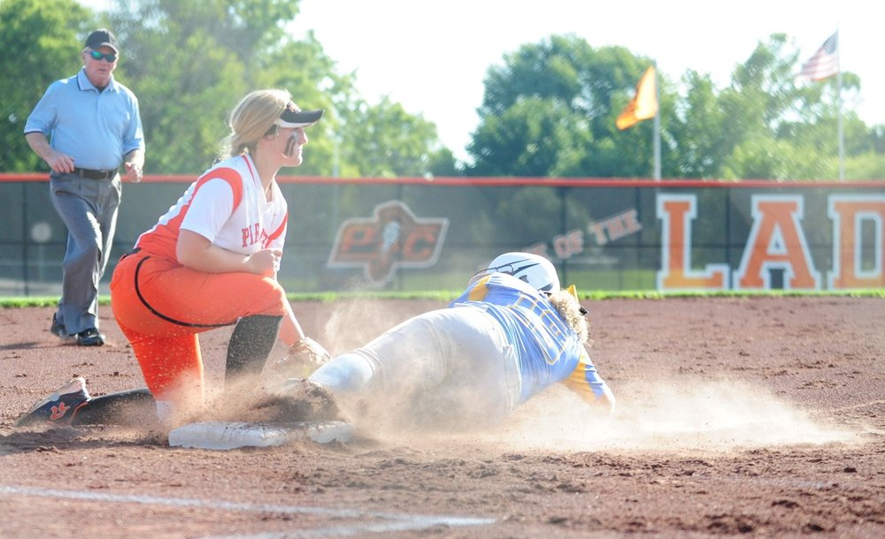 NICK INGRAM/Citizen photo Platte County sophomore Paige Rocha (left) tags out a Grandview runner at third base during a Suburban Conference Blue Division game Monday, Aug. 28 at Platte County High School.