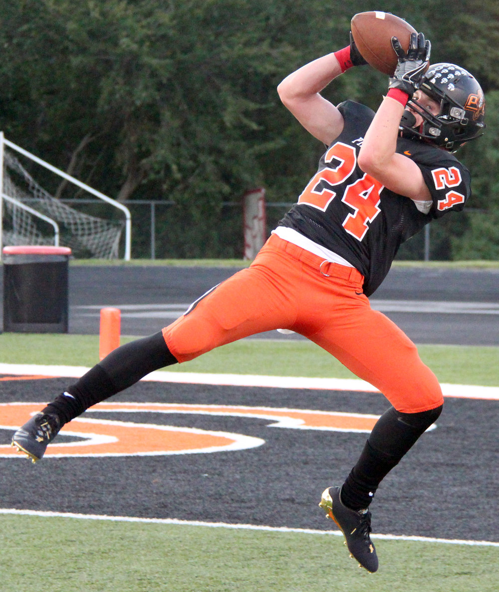 ROSS MARTIN/Citizen photo Platte County senior JP Post hauls in a pass that went for a 28-yard touchdown against Oak Park on Friday, Aug. 25 at Pirate Stadium. A defensive back, Post also had two interceptions in a 42-7 win.
