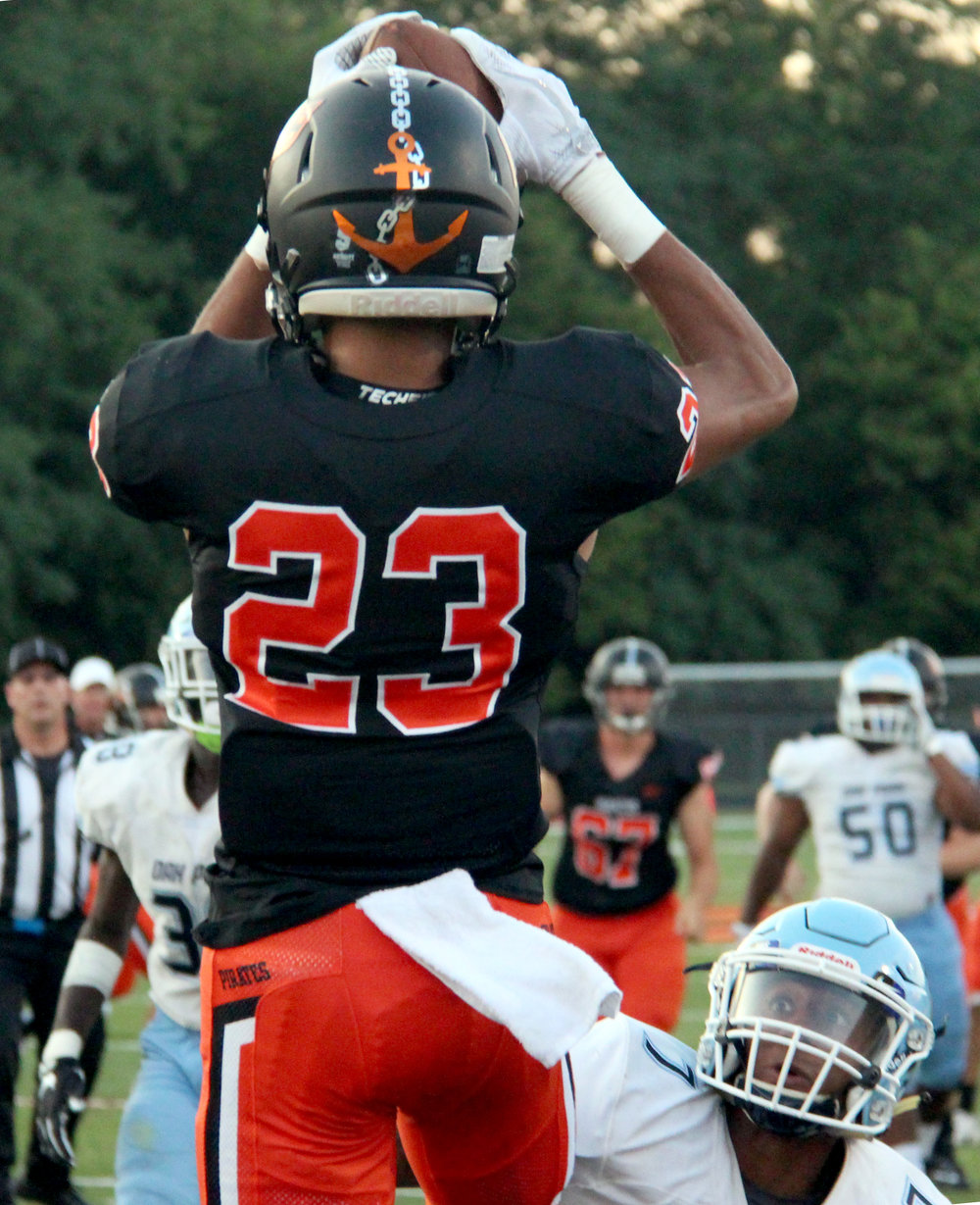 ROSS MARTIN/Citizen photo Platte County senior John Watts (23) makes a touchdown catch in front of an Oak Park defender Friday, Aug. 25.