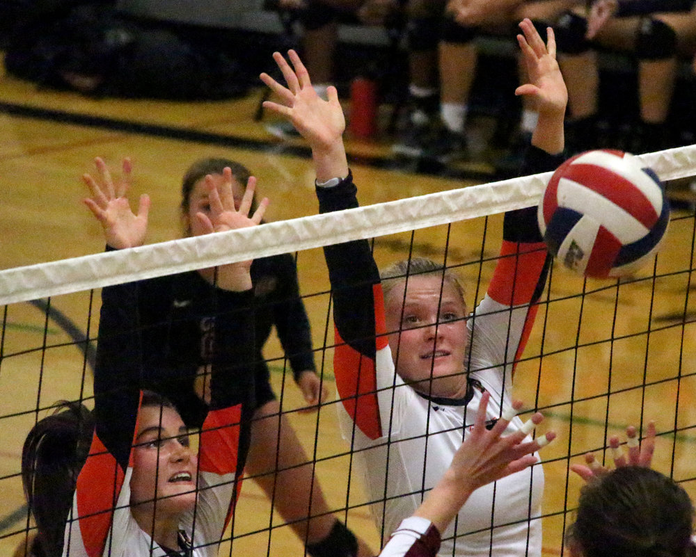 ROSS MARTIN/Citizen photo Platte County sophomore Ashley Bell, left, and senior Lauren Walker go up for a block against Lee's Summit North.