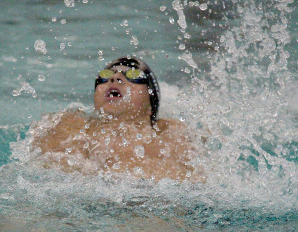 ROSS MARTIN/Citizen photo Platte County's Alex Beall swims the backstroke during the 200 medley relay, which the Pirates won.