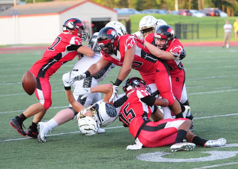 NICK INGRAM/Citizen photo Park Hill senior linebacker Brighton Ramirez (center) forces a Lee's Summit fumble during the first half.