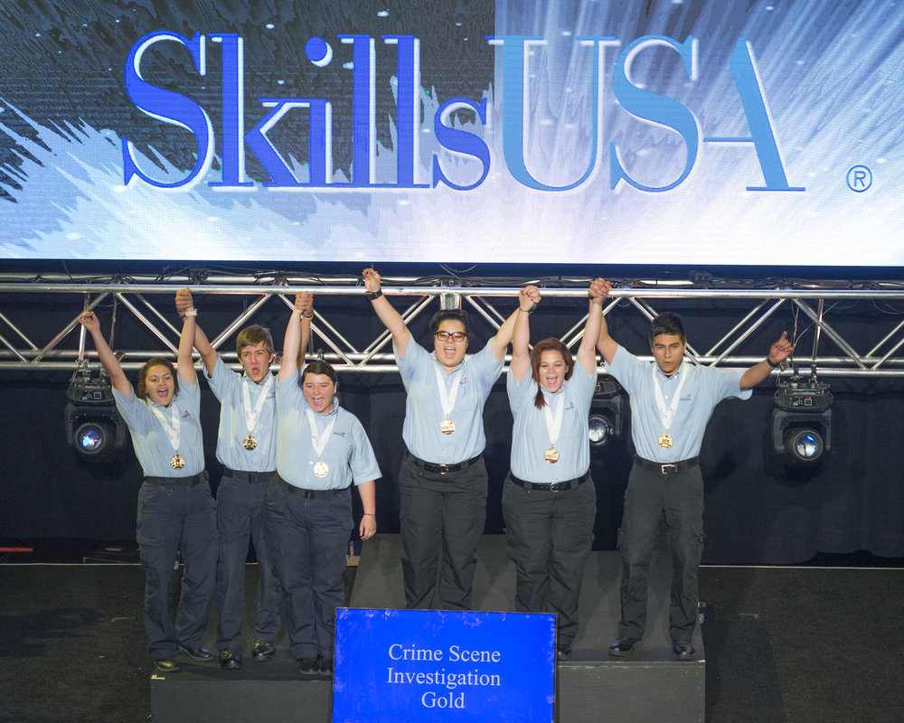 Contributed photo Northland Career Center students Colby Matthys, Jenna Abbott and Marena Draskovich won the SkillsUSA Championship national title in crime scene investigation over the summer. Matthys, pictured at left center, is a senior at Platte County High School. The group on the right is the post-secondary national championship winning group.