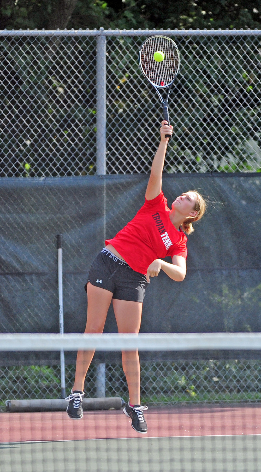 NICK INGRAM/Citizen photo Park Hill senior Lily Cota hits a serve during a dual with Lee's Summit North on Thursday, Aug. 31 at Barry Park in Kansas City, Mo.
