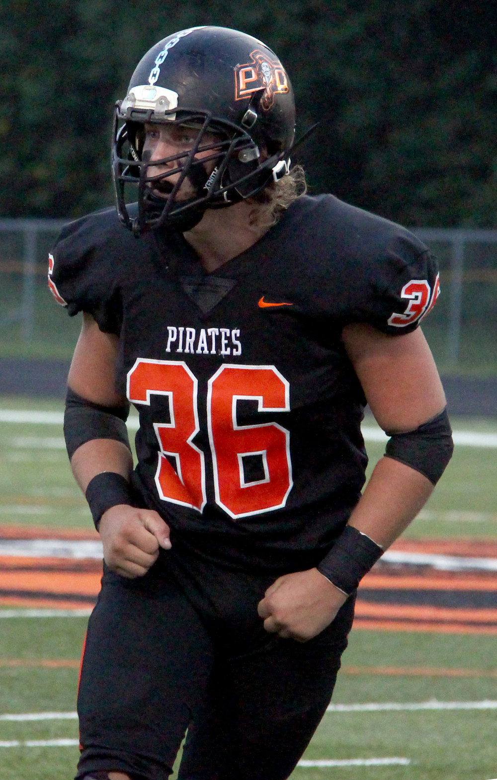 ROSS MARTIN/Citizen photo Platte County senior defensive lineman Chase Blankenship celebrates a tackle against Staley on Friday, Sept. 1 at Pirate Stadium.