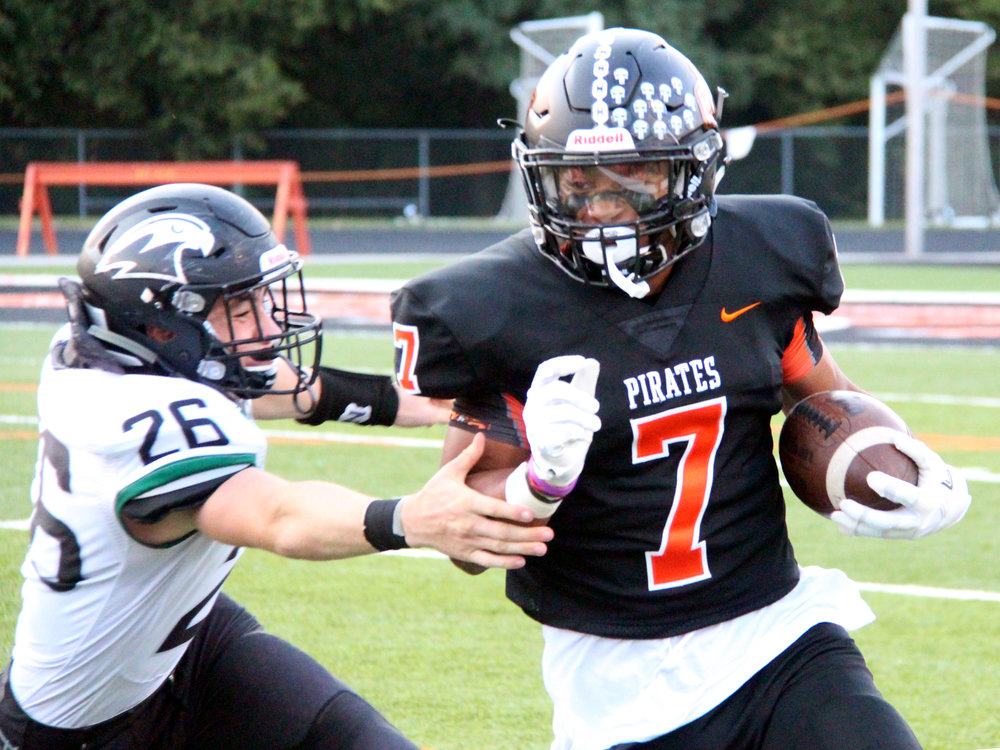 ROSS MARTIN/Citizen photo Platte County senior Kobe Cummings (7) pulls away from Staley defender Parker Heyne during the opening kickoff return Friday, Sept. 1 at Pirate Stadium.