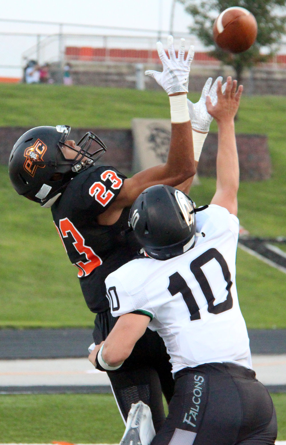 ROSS MARTIN/Citizen photo Platte County senior wide receiver John Watts, left, hauls in one of his two touchdown receptions against Staley on Friday, Sept. 1 at Pirate Stadium.