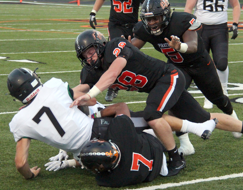 ROSS MARTIN/Citizen photo Platte County senior linebacker Dakota Schmidt (28) tackles Staley quarterback John Raybourn with help from senior defensive back Kobe Cummings (7) and senior defensive lineman Michael Smith (5) on Friday, Sept. 1 at Pirate Stadium.