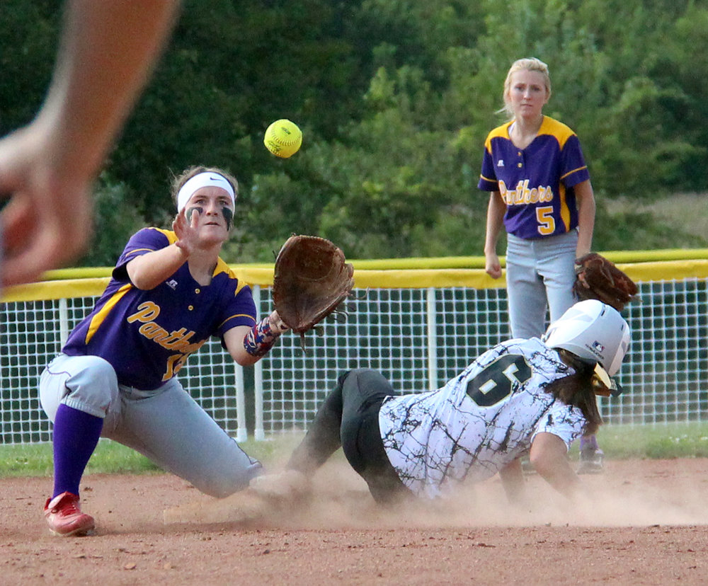 ROSS MARTIN/Citizen photos North Platte senior shortstop Alley Rickel, left, takes a throw from the catcher while Lathrop's Jacque Gentzell slides safely into second base.