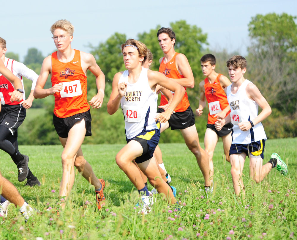 NICK INGRAM/Citizen photo Platte County senior Nick Bjustrom (497) and junior Keegan Cordova (second from left) run in the Liberty Invitational on Saturday, Sept. 2 at Stocksdale Park in Liberty, Mo.