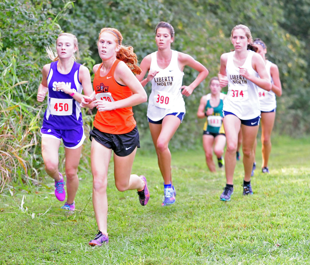 NICK INGRAM/Citizen photo Platte County senior Lauren Straubel runs at the front of a pack in the Liberty Invitational on Saturday, Sept. 2 at Stocksdale Park in Liberty, Mo.