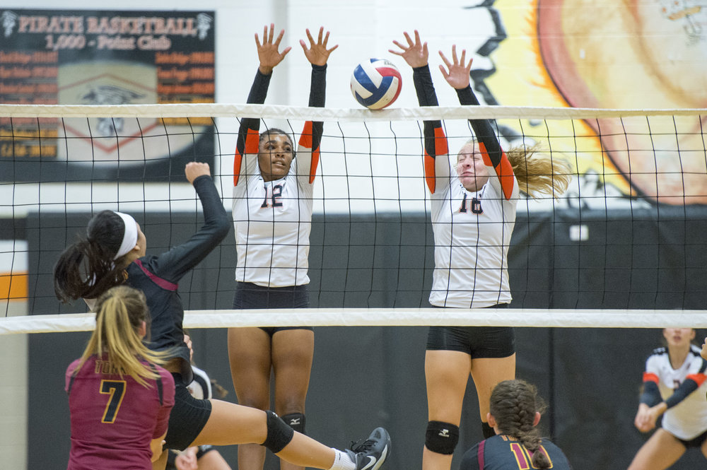 TODD NUGENT/Special to The Citizen Platte County seniors PJ Curry (12) and Lauren Walker (16) go up for a block in a Suburban Conference Blue Division match with Winnetonka on Thursday, Aug. 31 at Platte County High School.