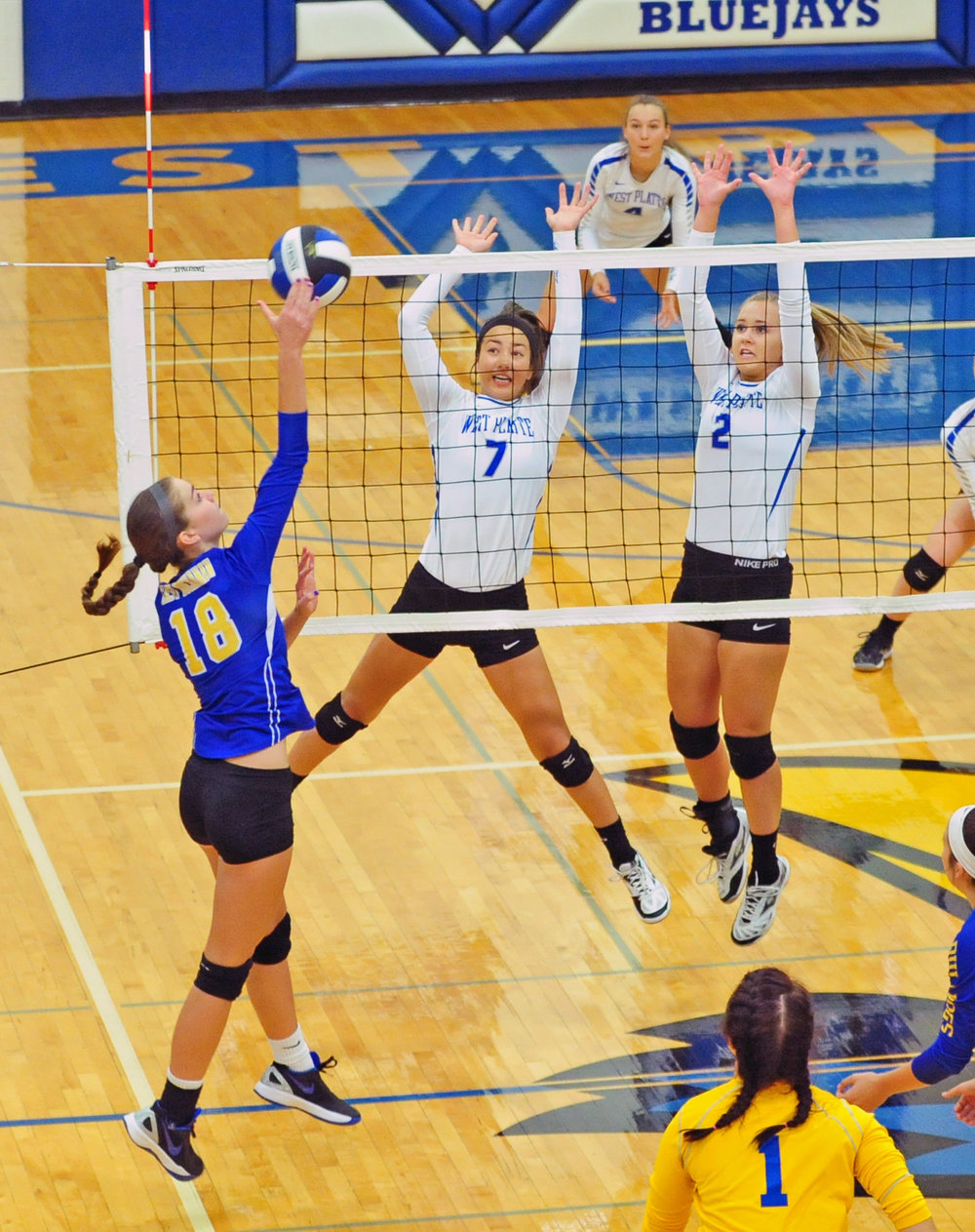 NICK INGRAM/Citizen photo West Platte sophomores Tori Norman (7) and Sam Rotterman (2) go up for a block against East Buchanan in a KCI Conference match Thursday, Sept. 7 at West Platte High School in Weston, Mo.