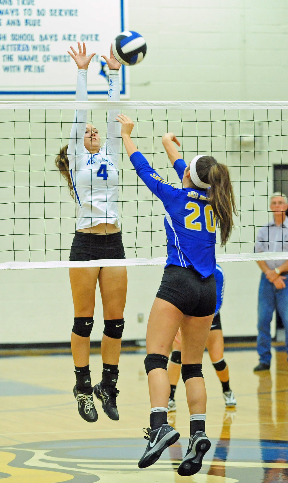 NICK INGRAM/Citizen photo West Platte senior Ciara Davies (4) goes up for a block against East Buchanan.