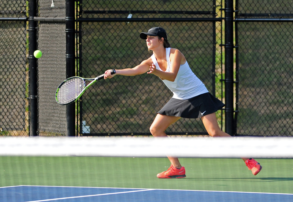 NICK INGRAM/Citizen photo Platte County junior Hannah Valentine hits a return shot in her singles match during a dual with Park Hill on Monday, Sept. 11 in Platte City.