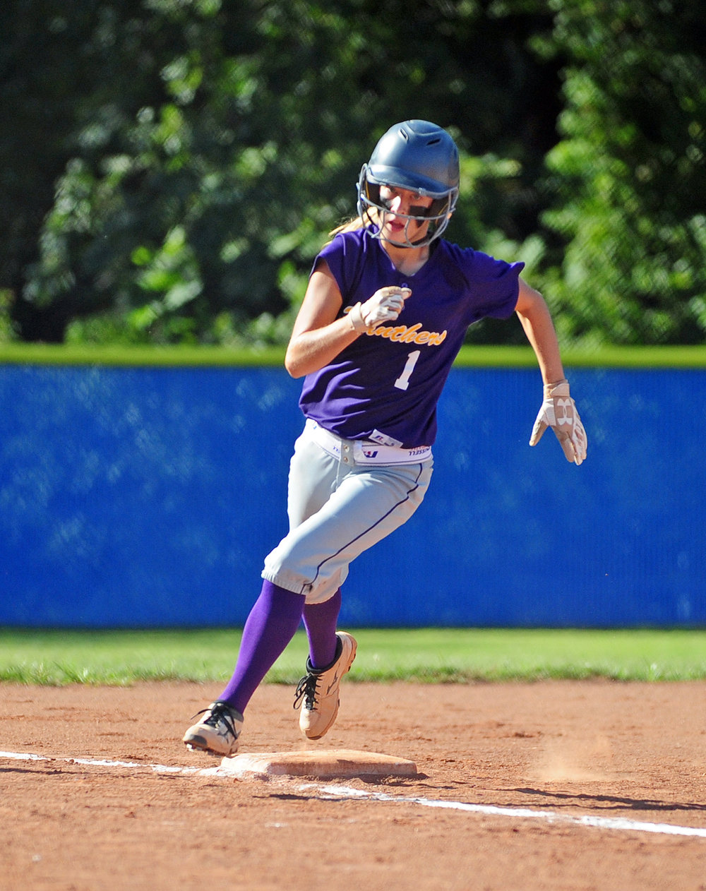 NICK INGRAM/Citizen photo North Platte junior McKenzie Sams rounds third base on her way home.