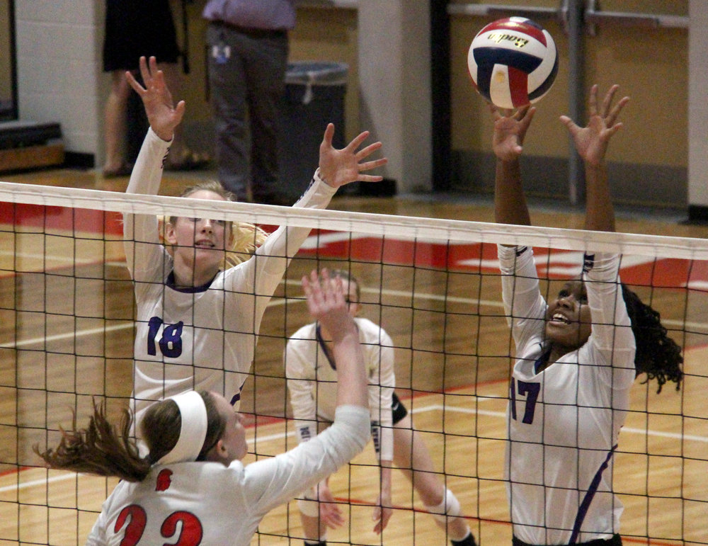 ROSS MARTIN/Citizen photo Park Hill South senior Annika Welty (18) and junior Kacy Lewallen go up for a block against Park Hill on Wednesday, Sept. 6 at Park Hill High School in Kansas City, Mo.