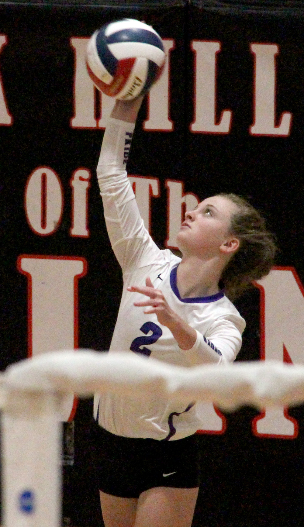 ROSS MARTIN/Citizen photo Park Hill South's Hannah Knight hits a serve against Park Hill on Wednesday, Sept. 6.