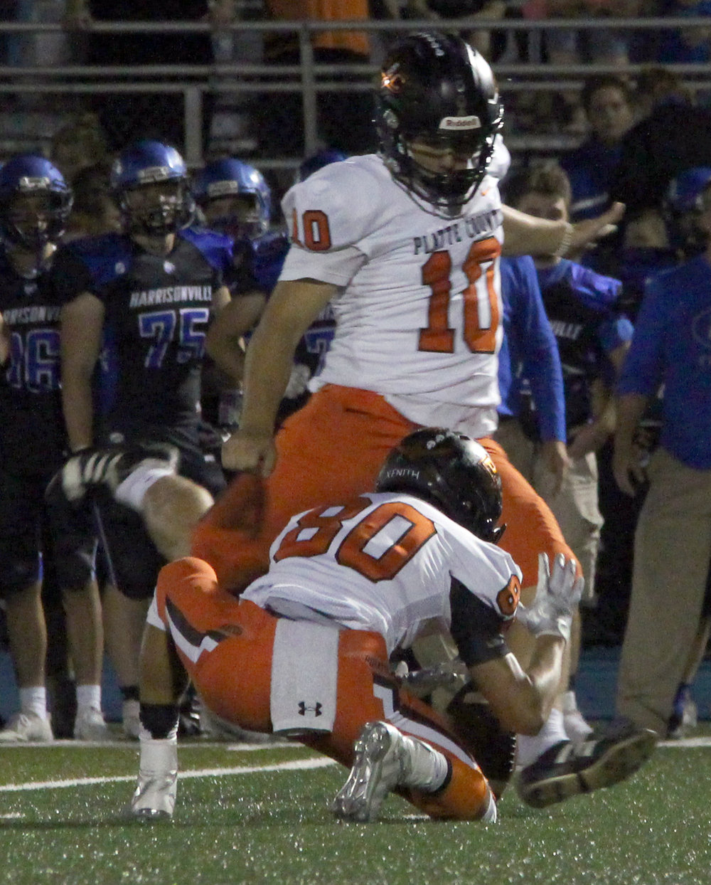 ROSS MARTIN/Citizen photo Platte County senior kicker Parker Lacina hits a late field goal out of the hold of Trey Phan against Harrisonville.