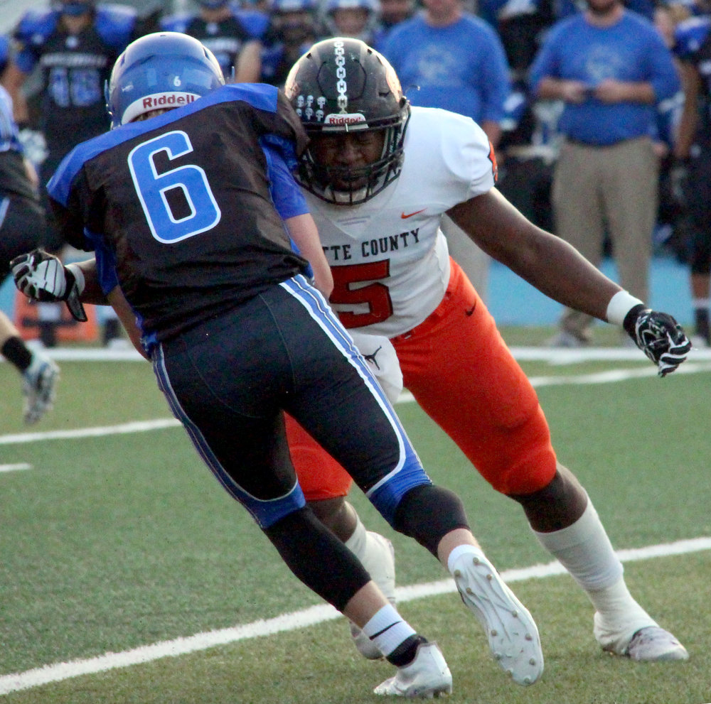 ROSS MARTIN/Citizen photo Platte County senior defensive end Michael Smith (5) makes a stop on Byrd.