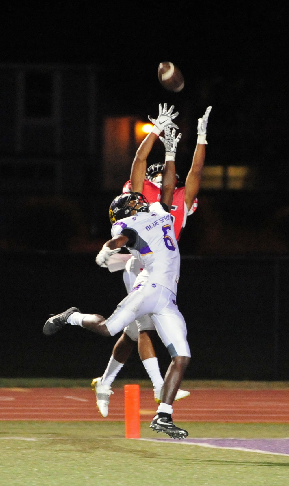 NICK INGRAM/Citizen photo Park Hill senior cornerback Devin Haney goes up to grab an interception over Blue Springs wide receiver Tre Wheaton on Friday, Sept. 8.