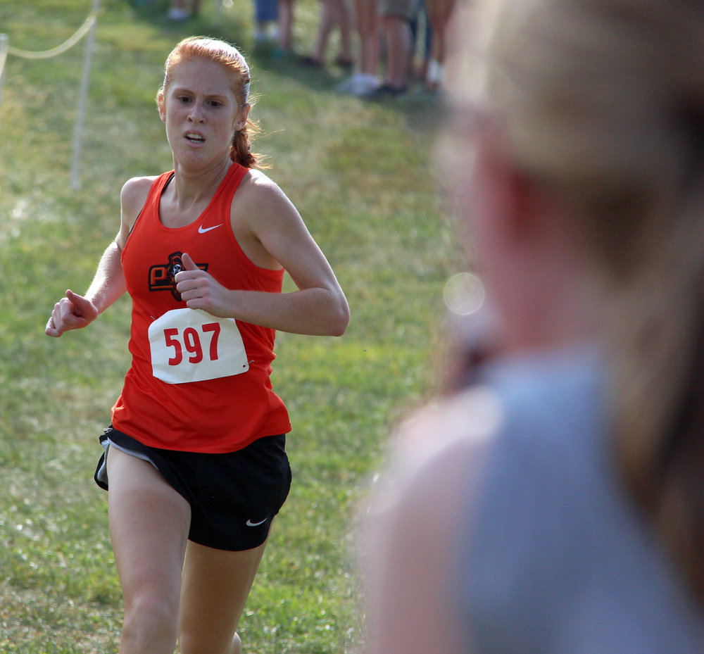 ROSS MARTIN/Citizen photo Platte County senior Erin Straubel nears the finish line in the Platte County Invitational on Thursday, Sept. 14 at Platte Ridge Park.