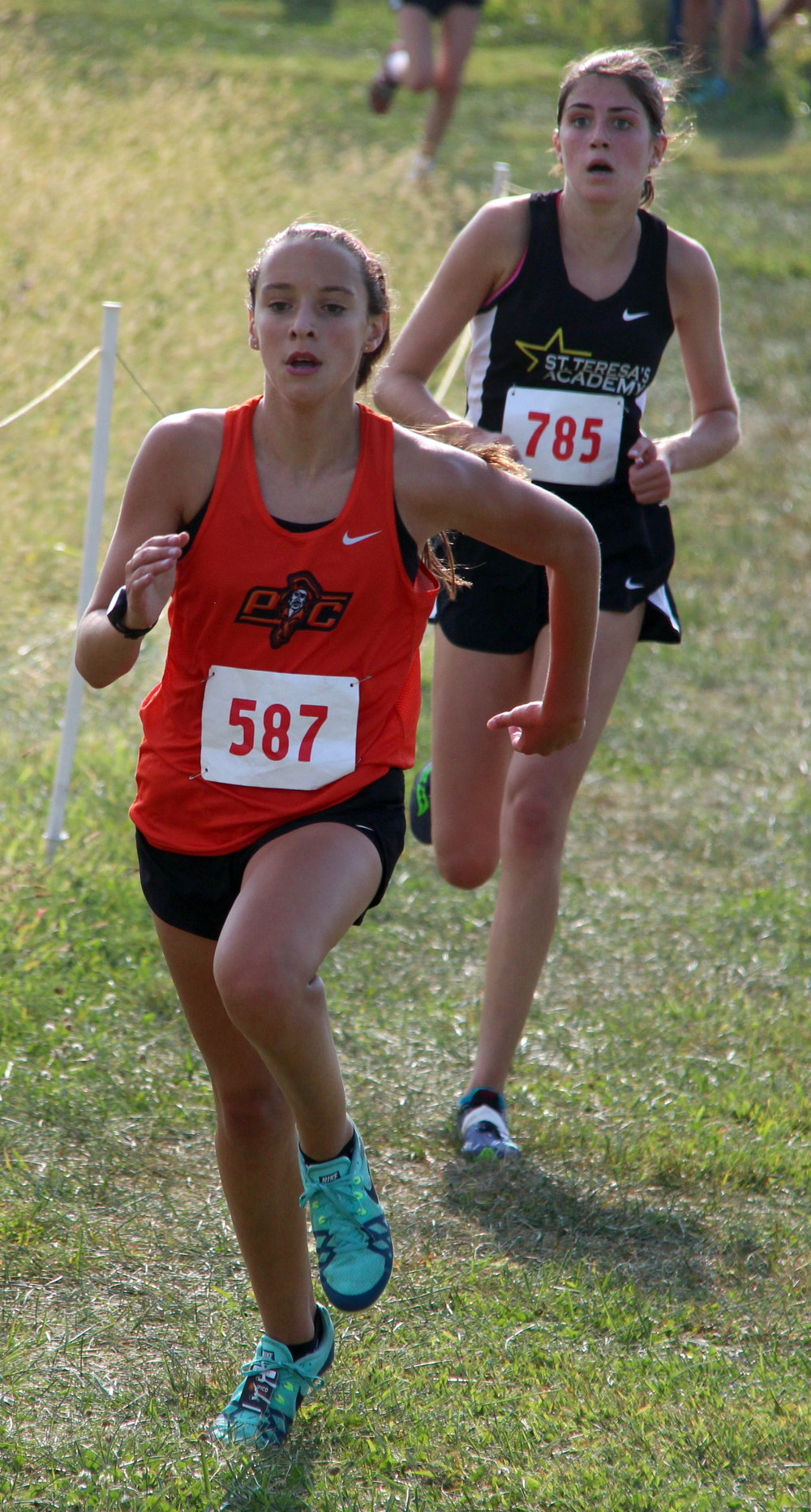 ROSS MARTIN/Citizen photo Platte County freshman Maddie Klippenstein approaches the finish line at Platte Ridge Park during the Platte County Invitational on Thursday, Sept. 14.